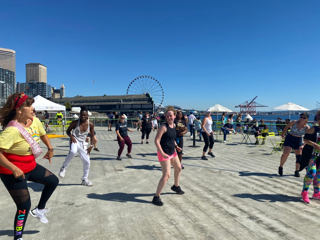 Keeya and others in a Zumba class on the pier